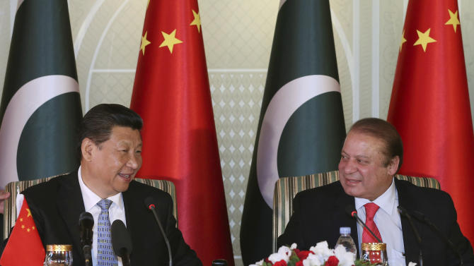 In this April 20, 2015 photo released by China's Xinhua News Agency, visiting Chinese President Xi Jinping, left and Pakistan's Prime Minister Nawaz Sharif attend a press conference after their talks in Islamabad, Pakistan. Xi is on a two-day visit in which he is expected to announce $45 billion worth of investment projects in energy and infrastructure development.  (Lan Hongguang/Xinhua via AP) NO SALES
