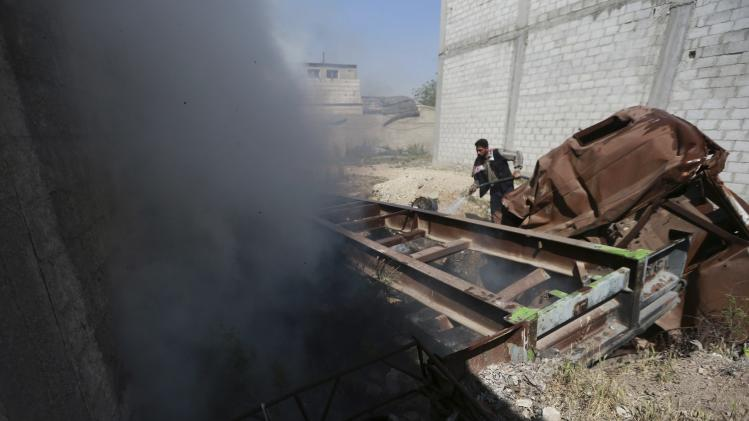 A man puts out a fire after what activists said was an airstrike by forces loyal to Syria's President Bashar al-Assad on the outskirts of the Duma neighbourhood of Damascus