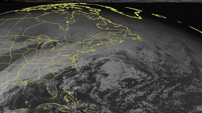 This NOAA satellite image taken Sunday, Dec. 28, 2014 at 12:45 PM EST shows a storm system developing over the Gulf coast a long a front that is associated with a storm over Canada. This is creating lots of cloudiness and areas of rain throughout the Eastern region.Behind the system is areas of clearing skies in the Mid-West down to Texas.(AP Photo/Weather Underground)