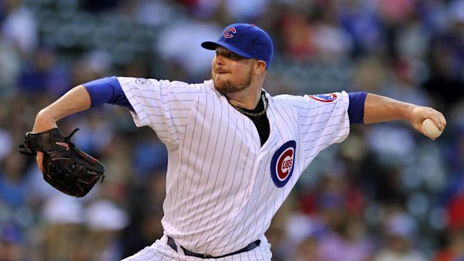 Chicago Cubs starter Jon Lester delivers a pitch during the first inning of a baseball game against the Washington Nationals in Chicago, Wednesday, May 27, 2015. (AP Photo/Paul Beaty)