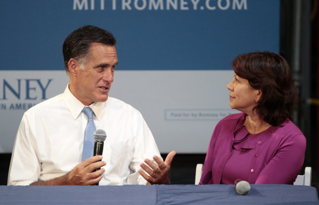 Republican presidential candidate, former Massachusetts Gov. Mitt Romney talks to Beverly Oncology and Imaging CEO Ruth Lopez Novodor during a small-business roundtable during a campaign stop at Endural LLC, Monday, July 23, 2012, in Costa Mesa, Calif. (AP Photo/Jason Redmond)