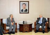Syrian Foreign Minister Walid Muallem (R) speaks with international peace envoy Lakhdar Brahimi during a meeting in Damascus. Brahimi on Saturday pressed in Damascus for a truce to break the cycle of bloodshed in Syria, while the regime said a national dialogue free of foreign interference held the key