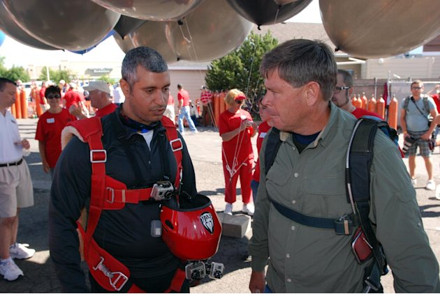 Gas station owner Kent Couch, right, confers with Iraqi adventurer Fareed Lafta  before taking off from Bend, Ore., in tandem lawn chairs suspended from helium-filled party balloons, Saturday, July 14