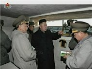 North Korean leader Kim Jong-un (C) speaks with senior military officials at an undisclosed location, in this still image taken from video shown by North Korea&#39;s state-run television KRT on March 8, 2013. REUTERS/KRT via Reuters TV