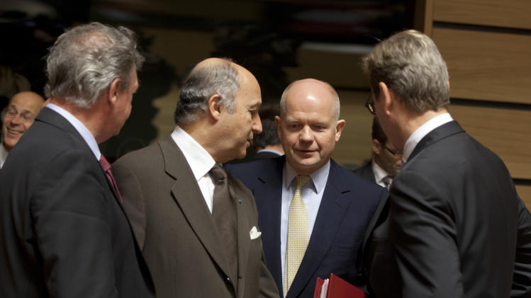 From left, Luxembourg's Foreign Minister Jean Asselborn, French Foreign Minister Laurent Fabius, British Foreign Minister William Hague and German Foreign Minister Guido Westerwelle share a word during a meeting of EU Foreign Ministers in Luxembourg on Monday Oct. 15, 2012. Britain, Germany and France say they expect the European Union to approve even tougher sanctions on Iran to prevent it from developing nuclear weapons. (AP Photo/Virginia Mayo)