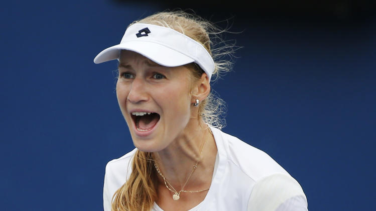 Ekaterina Makarova, of Russia, reacts after defeating Zarina Diyas, of Kazakhstan, during the third round of the 2014 U.S. Open tennis tournament, Saturday, Aug. 30, 2014, in New York. (AP Photo/Elise Amendola)