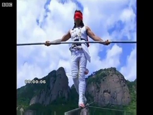 Chinese acrobat 'survives high wire fall'