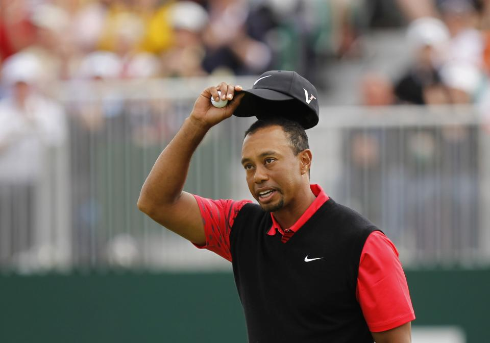 Tiger Woods of the United States reacts on the 18th green at Royal Lytham & St Annes golf club after his final round of the British Open Golf Championship, Lytham St Annes, England Sunday, July  22, 2012. (AP Photo/Peter Morrison)