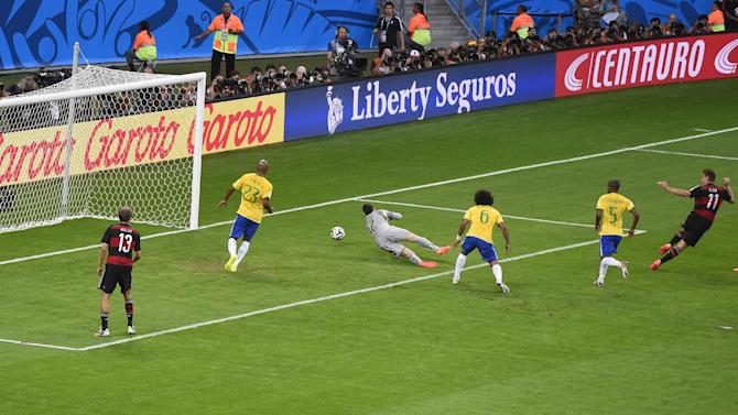 Germany's forward Miroslav Klose (right) scores during the semi-final match between Brazil and Germany at the Mineirao Stadium in Belo Horizonte during the 2014 FIFA World Cup on July 8, 2014