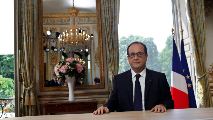 France's President Francois Hollande after the traditional interview following the bastille day parade, at the Elysee Palace, in Paris, Monday, July 14, 2014. Hollande is urging partners to talk to Hamas and is pressing Israel for calm in hopes of reaching a cease-fire in Gaza. (AP Photo/Thibault Camus, Pool)