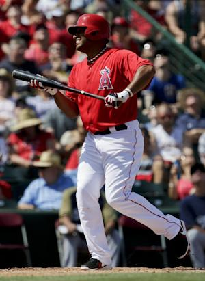 In this photo taken March 23, 2013, Los Angeles Angels' Vernon Wells strikes out against the Milwaukee Brewers during the third inning of a spring training baseball game in Tempe, Ariz. Wells might become the latest addition to the New York Yankees' injury-depleted lineup. (AP Photo/Chris Carlson)