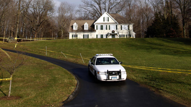 FILE - In this Dec. 18, 2012 file photo, a police cruiser sits in the driveway and crime scene tape surrounds the home of Nancy Lanza in Newtown, Conn.  Nancy Lanza was killed in the home by her son Adam Lanza before he forced his way into Sandy Hook Elementary School in Newtown, Conn, killing 26 people. Search warrants released Thursday, March 28, 2013, revealed that an arsenal of weapons including guns, more than a thousand rounds of ammunition, a bayonet and several swords was seized in the Lanza home.  (AP Photo/Jason DeCrow)