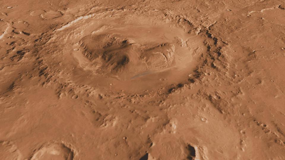 This undated image made available by NASA shows Mars' Gale Crater, looking south. The formation is 96 miles (154 kilometers) in diameter and holds a layered mountain rising about 3 miles (5 kilometers) above the crater floor. (AP Photo/NASA)