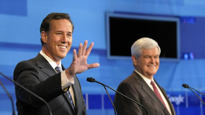 Republican presidential candidate former Pennsylvania Sen. Rick Santorum, left,  waves to a member of the audience as former House Speaker Newt Gingrich looks on, prior to a debate Thursday, Sept. 22, 2011, in Orlando, Fla.  (AP Photo/Phelan M. Ebenhack)