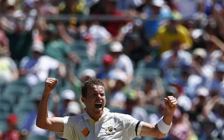 Australia's Peter Siddle celebrates after taking the wicket of England's Kevin Pietersen during the third day of the second Ashes test cricket match at the Adelaide Oval December 7, 2013. REUT