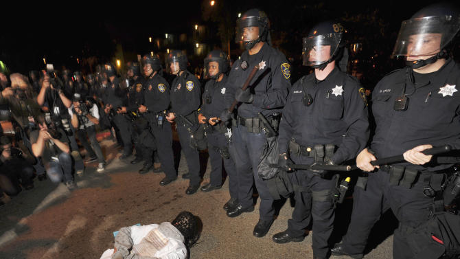 A demonstrator lies on ground in protest after the sentencing in Oakland, Calif., Friday, Nov. 5, 2010 of former Bay Area Rapid Transit police officer Johannes Mehserle. Mehserle was convicted of involuntary manslaughter for the fatal shooting of Oscar Grant at a BART station on Jan. 1, 2009. Los Angeles Superior Court Judge Robert Perry sentenced Mehserle  to two years in prison. (AP Photo/Noah Berger)