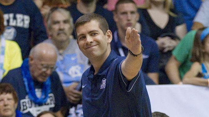 Butler coach Brad Stevens signals to one of his players in the first half of an NCAA college basketball game against North Carolina in the Maui Invitational on Tuesday, Nov. 20, 2012, in Lahaina, Hawaii. (AP Photo/Eugene Tanner)