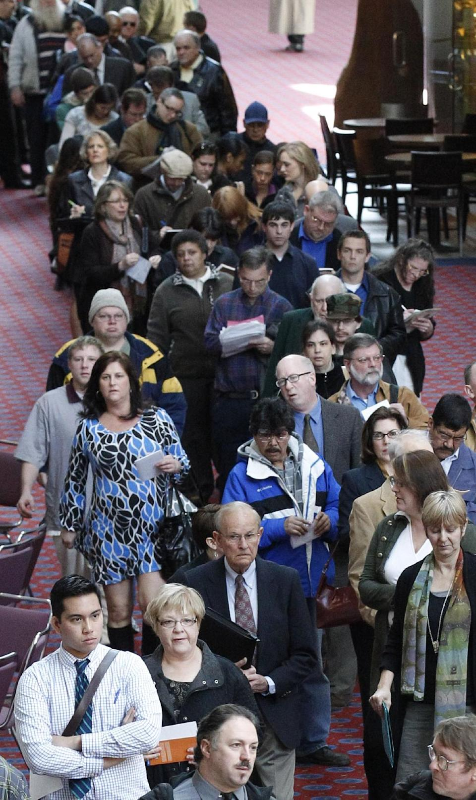 File - In a March 7, 2012, file photo  job seekers stand in line during the Career Expo job fair, in Portland, Ore.  Economists predict employers added 163,000 jobs in April. That would be better than the disappointing 120,000 jobs created in March.    (AP Photo/Rick Bowmer)
