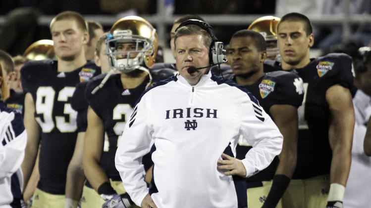 Notre Dame head coach Brian Kelly watches his team on the field against Florida State during the final moments of the Champs Sports Bowl NCAA college football game, Thursday, Dec. 29, 2011, in Orlando, Fla. Florida State won 18-14. (AP Photo/John Raoux)