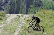 Lance Armstrong finishes the Power of Four Mountain Bike Race on Aspen Mountain in Aspen, Colorado. Armstrong, branded a drug cheat and banned from cycling by the US Anti-Doping Agency, was back on a bike in Colorado on Saturday and loving every minute of it