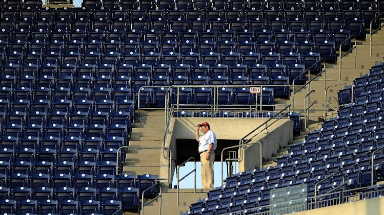 A Philadelphia Phillies staff member stands at the entrance to the upper levels at Citizens Bank Park during a baseball game against the San Francisco Giants on Monday, July 21, 2014, in Philadelphia. (AP Photo/Michael Perez)