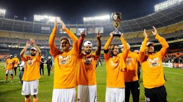 Brad Davis holds the Eastern Conference championship trophy in celebration with Houston Dynamo team-mates (AFP)