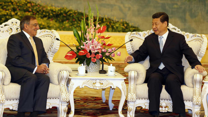 U.S. Defense Secretary Leon Panetta, left, sits with China's Vice President Xi Jinping at the Great Hall of the People in Beijing, China Wednesday, Sept. 19, 2012. Panetta met Wednesday with Chinese leader-in-waiting Xi, who just days ago reappeared after a puzzling two-week disappearance. (AP Photo/Larry Downing, Pool)