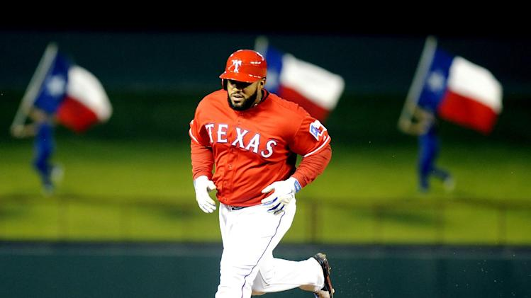 Texas Rangers first baseman Prince Fielder (84) rounds the bases after a home run in the fourth inning of a baseball game against the Chicago White Sox, Saturday, April 19, 2014, in Arlington, Texas. (AP Photo/Matt Strasen)