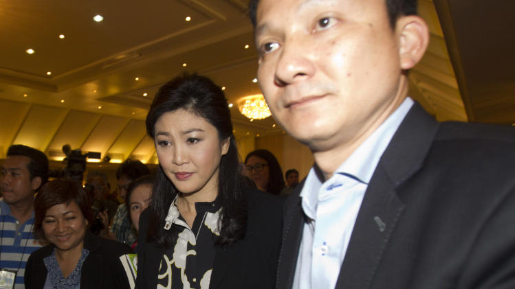 after a press conference in Bangkok, Thailand, Friday, July 18, 2014