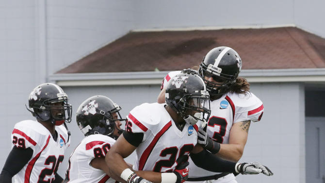Valdosta State's Matt Pierce (26) celebrates his touchdown on the opening kickoff with teammates Chas Matthews, right, Chris Anderson (80) and Eric Scott (29) in the first half an NCAA Div II national championship college football game against Winston Salem State at Braly Municipal Stadium in Florence, Ala., Saturday, Dec. 15, 2012. (AP Photo/Dave Martin)