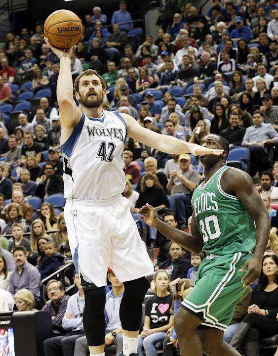 Minnesota Timberwolves' Kevin Love, left, shoots as Boston Celtics' Brandon Bass looks on in the first quarter of an NBA basketball game on Saturday, Nov. 16, 2013, Minneapolis