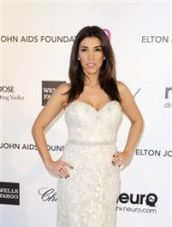 "Adrianna Costa from the ""Extra"" TV series arrives at the 2013 Elton John AIDS Foundation Oscar Party in West Hollywood, California, February 24, 2013. REUTERS/Gus Ruelas"