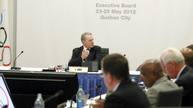 International Olympic Committee President Jacques Rogge gestures as the members of the IOC Executive Board wrap up a meeting during the SportAccord conference in Quebec city, Wednesday, May 23, 2012. (AP Photo/The Canadian Press, Mathieu Belanger, Pool)
