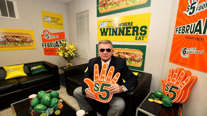 ESPN analyst Mike Ditka stops by the Subway Fresh Take Green Room before heading on the set of ESPN's Mike & Mike in the Morning for Super Week in New Orleans on Friday, Feb. 1, 2013. (Photo by Barry Brecheisen/Invision for SUBWAY/AP Images)
