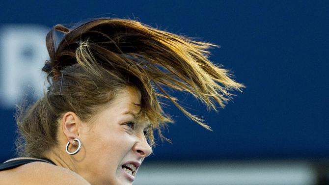Bojana Jovanovski, of Serbia, watches a serve to Maria Sharapova, of Russia, at the Rogers Cup tennis tournament in Toronto on Wednesday, Aug. 10, 2011. (AP Photo/The Canadian Press, Nathan Denette)