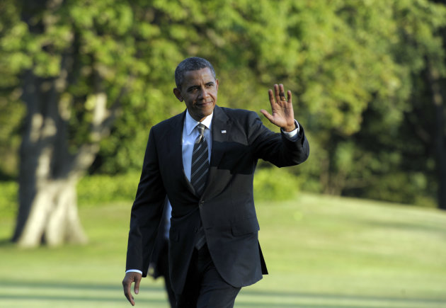 President Barack Obama waves as he walks from Marine One on the South Lawn of the White House in Washington, Wednesday, Aug. 29, 2012, after returning from campaigning. (AP Photo/Susan Walsh)