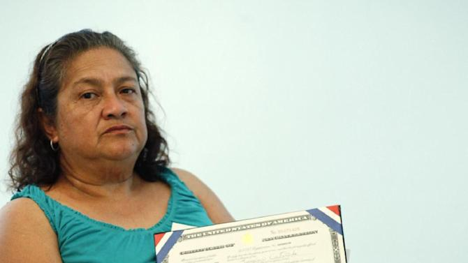 In this Oct. 2, 2012, photo, Georgina Castaneda, a new citizen who registered to vote Democratic at a swearing-in ceremony in March, when she took the U.S. citizenship oath, poses for a photo at her home in Los Angeles. From Florida to Massachusetts and Iowa to California, candidates and political parties seeking to squeeze every vote they can from a divided electorate are targeting America's newest citizens, a bloc relatively small in number but substantial enough to make a difference in presidential swing states. (AP Photo/Damian Dovarganes)