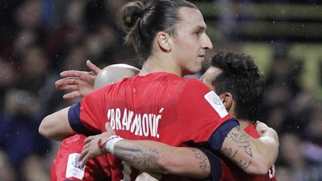 Paris Saint-Germain's Zlatan Ibrahimovic and teammates celebrate after scoring the second goal during their French Ligue 1 soccer match against Toulouse, in Toulouse February 1, 2013 (Reuters)