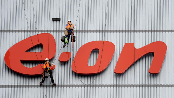 FILE - In this Aug. 3, 2011 file photo workers clean the company's logo at a building of E.On in Datteln, western Germany. German electricity and gas supplier E.ON AG on Tuesday Nov. 13, 2012 lowered its earnings forecast for next year because of economic uncertainties and changes in the energy industry, an announcement that caused its shares to tumble. The reduced forecast came as the utility, which is based in Duesseldorf, reported a euro 179 million ($228 million) loss for the third quarter. (AP Photo/dapd/Volker Hartmann, File)