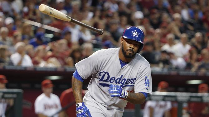 Los Angeles Dodgers' Howie Kendrick tosses his bat away after earning a walk against the Arizona Diamondbacks during the fourth inning of a baseball game Monday, June 29, 2015, in Phoenix. (AP Photo/Ross D. Franklin)