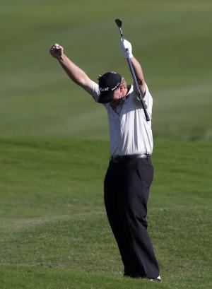 Steve Stricker raises his arms after hitting for an eagle on the 18th hole during the second round at the Tournament of Champions PGA golf tournament Monday, Jan. 7, 2013 in Kapalua, Hawaii. (AP Photo/Elaine Thompson)