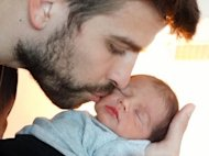 Gerard Pique seen with his newborn son Milan on February 4, 2013