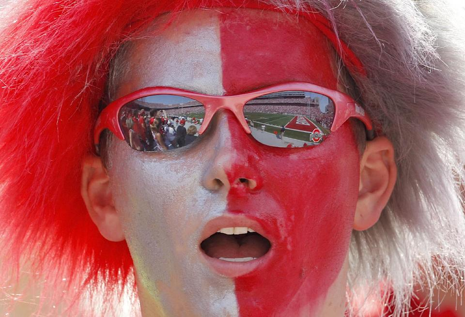 A fan of Ohio State cheers on his team as they face Akron in an NCAA college football game in Columbus, Ohio on Saturday, Sept. 3, 2011.  (AP Photo/Amy Sancetta)