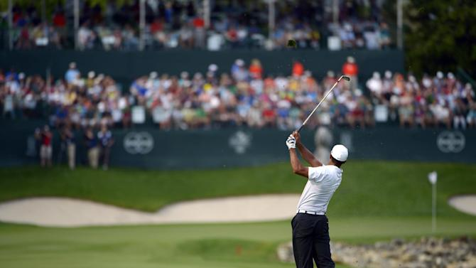 Tiger Woods watches his shot from the 18th fairway during the third round of the Arnold Palmer Invitational golf tournament in Orlando, Fla., Saturday, March 23, 2013. (AP Photo/Phelan M. Ebenhack)