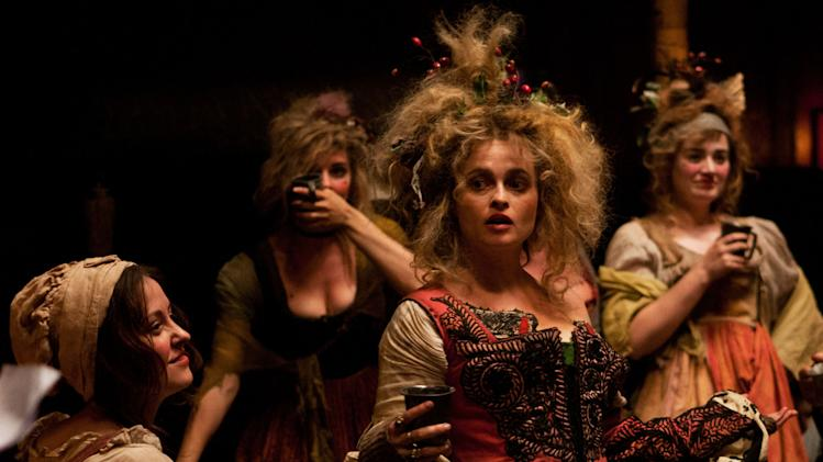 "This undated publicity photo provided by Universal Pictures shows, center, Helena Bonham Carter as Madame Thénardier in a scene from the film, ""Les Misérables."" (AP Photo/Universal Pictures/Laurie Sparham)"