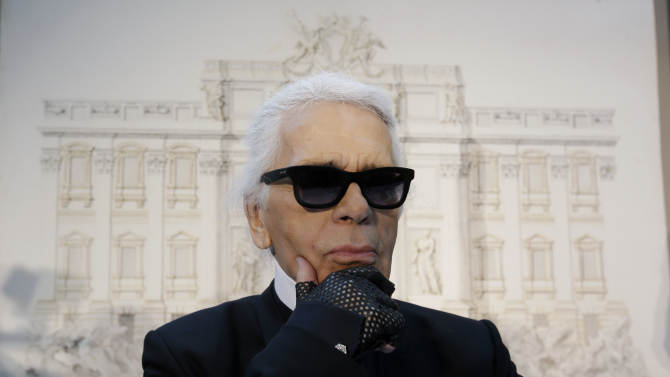 "Designer Karl Lagerfeld poses for photographers prior to the start of a press conference, in Rome, Monday, Jan. 28, 2013. The Fendi fashion house is financing an euro 2.12 million ($2.8 million) restoration of Trevi Fountain in Rome, famed as a setting for the film ""La Dolce Vita'' and the place where dreamers leave their coins. The 20-month project on one of the city's most iconic fountains was being unveiled at a city hall press conference Monday. (AP Photo/Gregorio Borgia)"