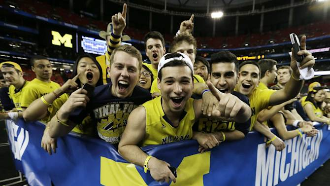 Michigan fans cheer before the first half of the NCAA Final Four tournament college basketball championship game against the Louisville, Monday, April 8, 2013, in Atlanta. (AP Photo/Charlie Neibergall)