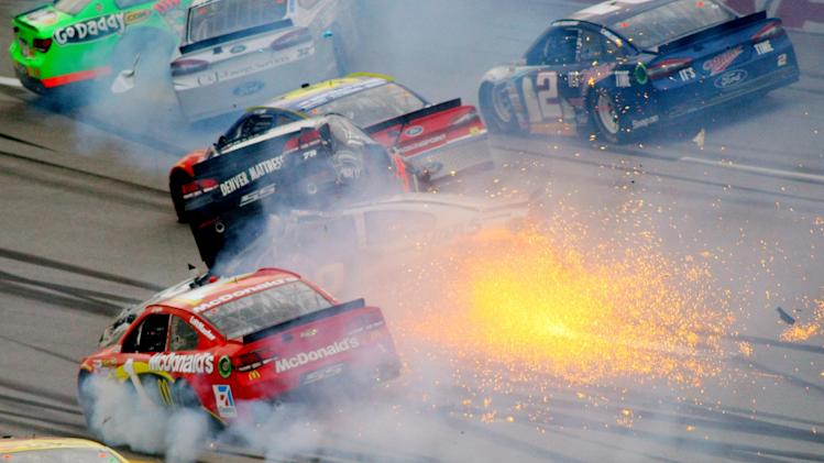 Drivers including Jamie McMurray (1) and Kurt Busch (78), atop Ryan Newman (39), collide as Brad Keselowski drives through the wreck in Turn 3 during the NASCAR Sprint Cup Series Aaron's 499 auto race at Talladega Superspeedway in Talladega, Ala., Sunday, May 5, 2013. (AP Photo/Greg McWilliams)
