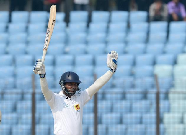 Sri Lankan batsman Kumar Sangakkara acknowledges the crowd after scoring a triple century (300 runs) during the second day of the second Test match between Bangladesh and Sri Lanka at The Zahur Ahmed