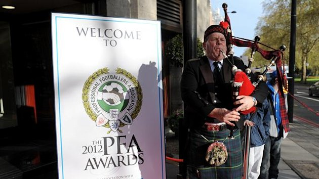 A bagpipe player welcomes guests to the 2012 PFA awards ceremony outside the Grosvenor House Hotel (PA Photos)